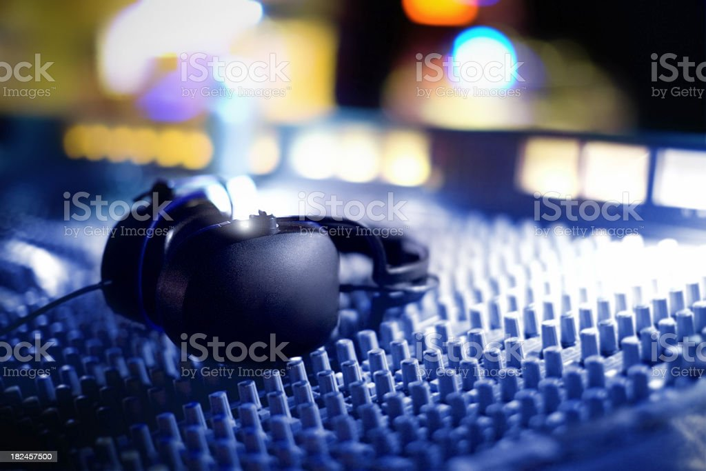 Audio mixing Console and Headphones stock photo