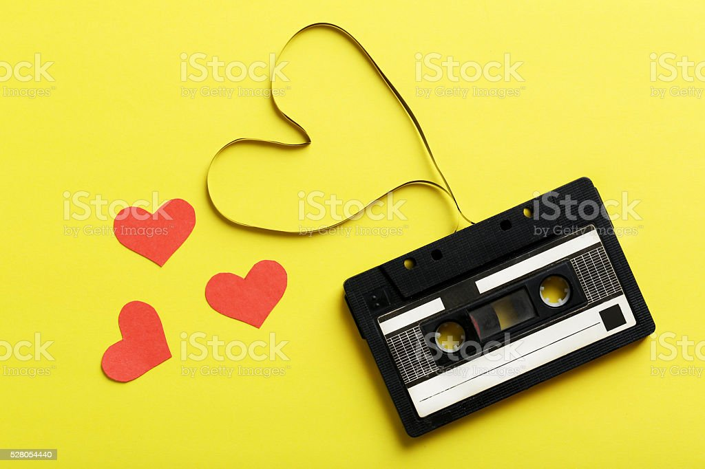 Audio tape cassette on yellow paper background stock photo