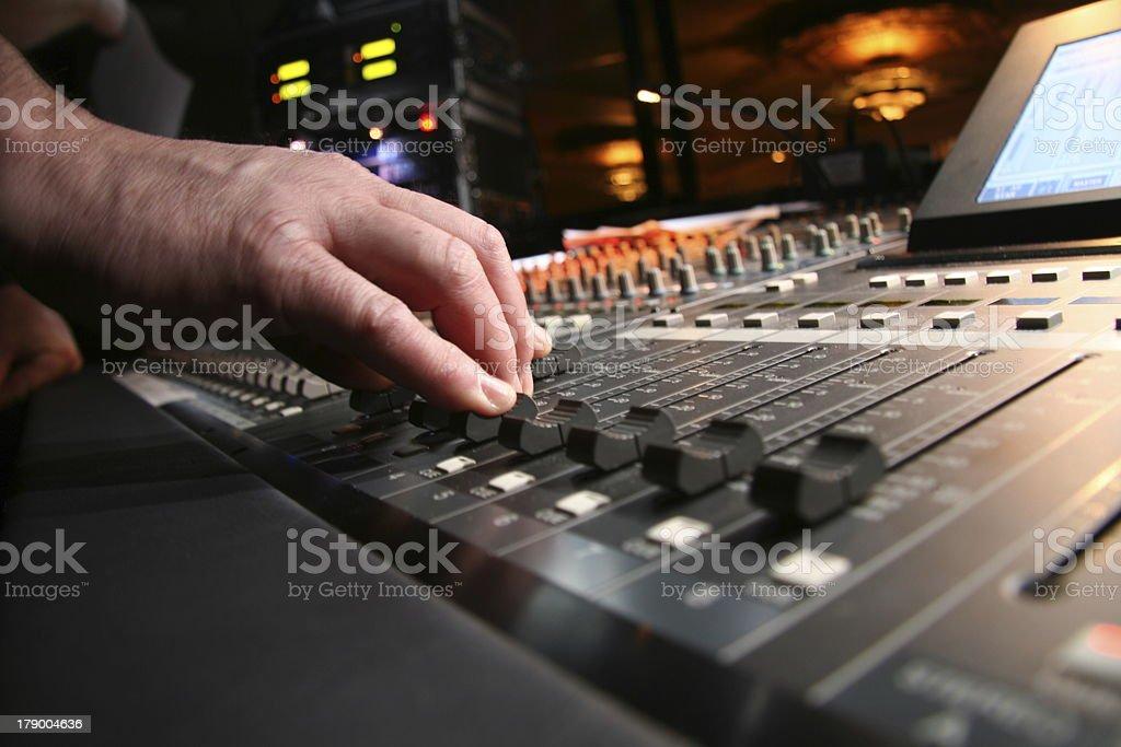 Audio technician at sound board stock photo