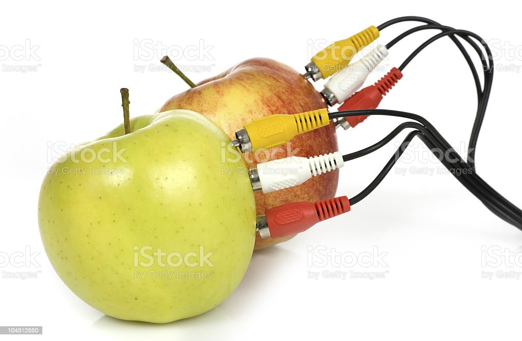 Audio video cables on apple. stock photo