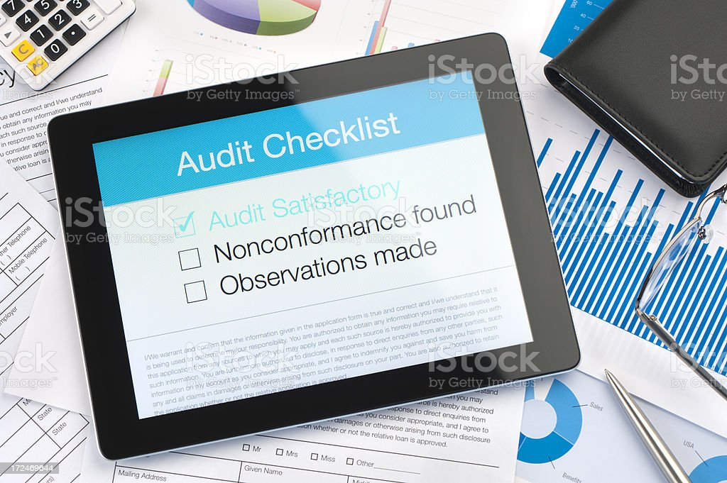Audit checklist on a digital tablet stock photo