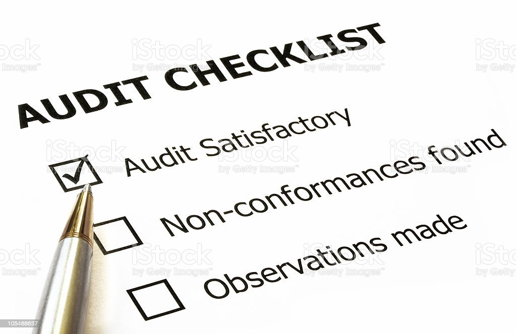 Audit checklist with black pen for writing royalty-free stock photo