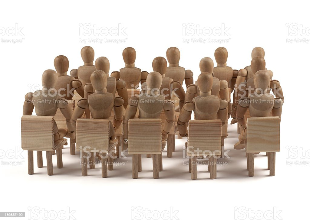 Auditorium of wooden mannequins royalty-free stock photo