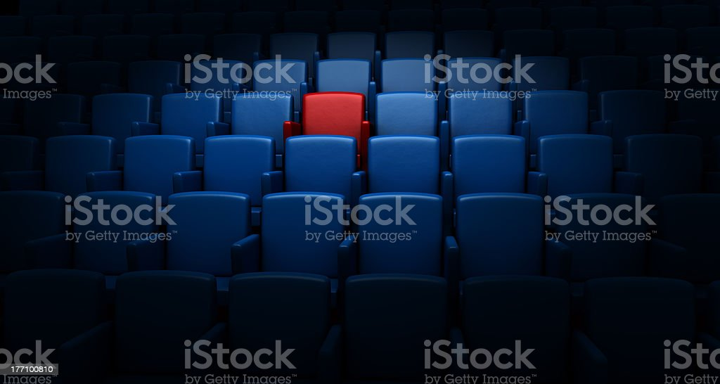 auditorium with one reserved seat royalty-free stock photo