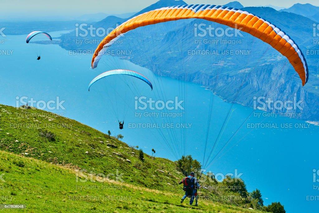MONTE BALDO, ITALY, August 17 2014: Paragliding is a popular activity on Lake Garda stock photo
