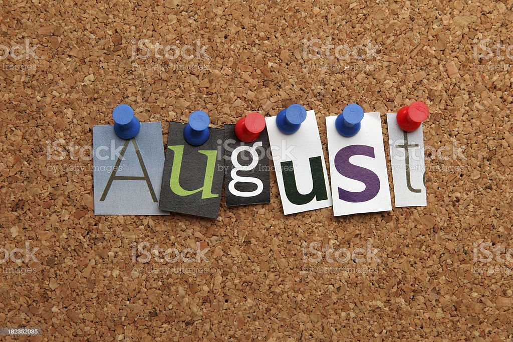 August pinned on noticeboard stock photo