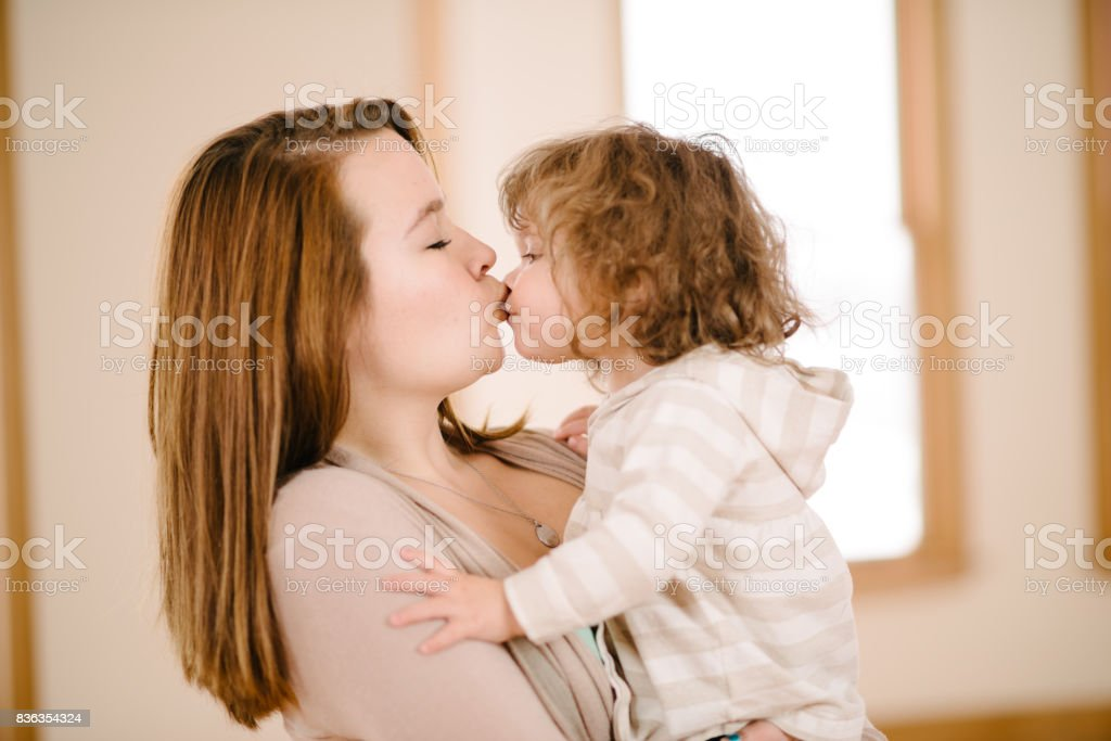 Aunt kissing niece stock photo