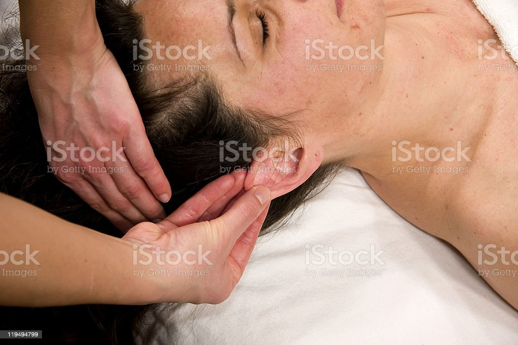 auricle massage royalty-free stock photo
