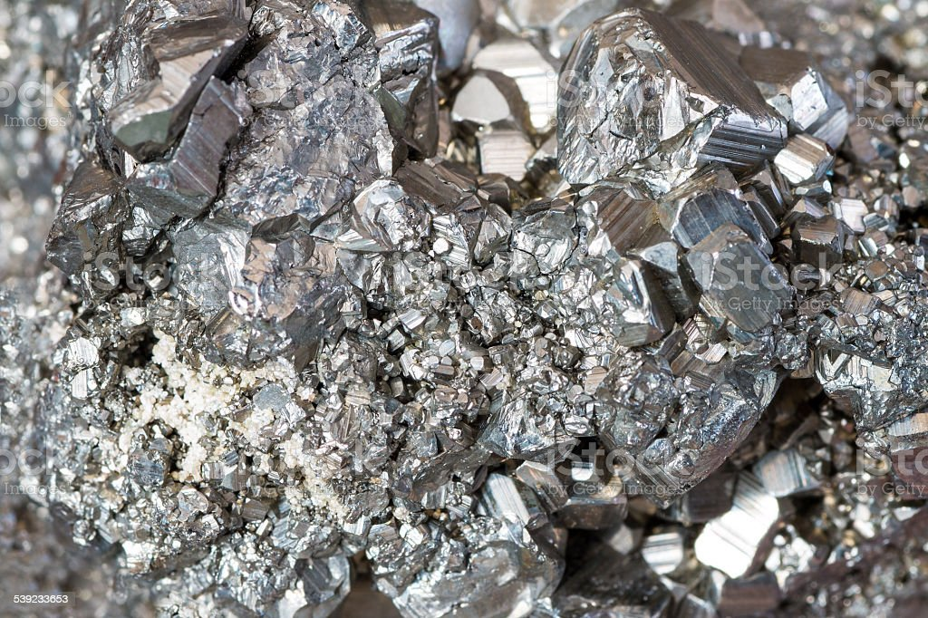 Auriferous Pyrite (Fe S2) gray stone crystals background stock photo