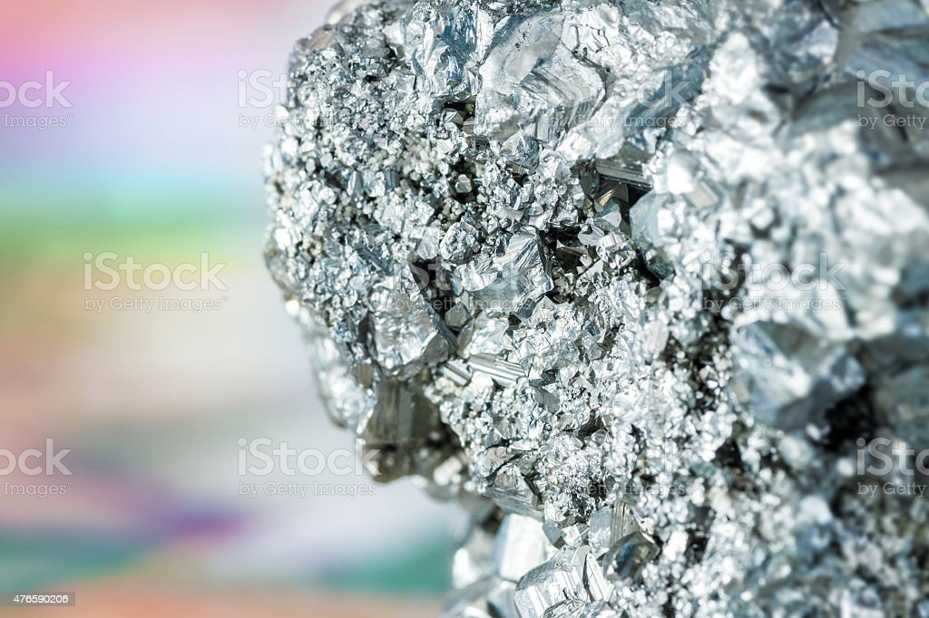 Auriferous Pyrite gray stone crystals on colored background stock photo