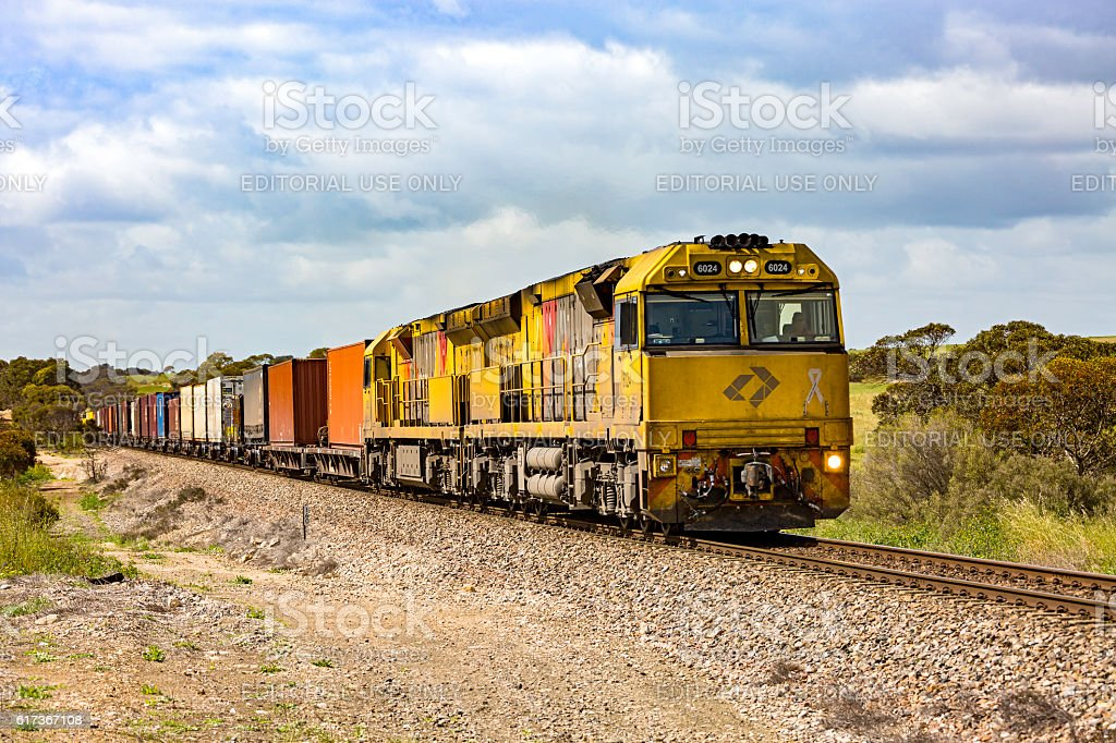 Aurizon long-haul freight train in rural countryside stock photo