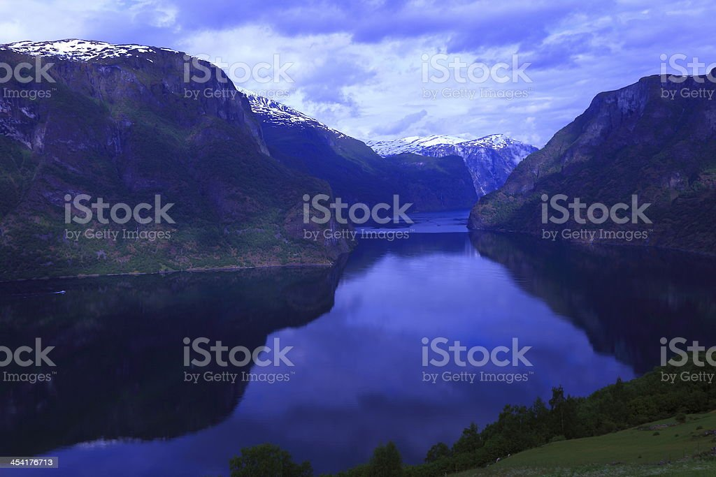 Aurland fjord mountains reflection at dawn, Norway, Scandinavia stock photo