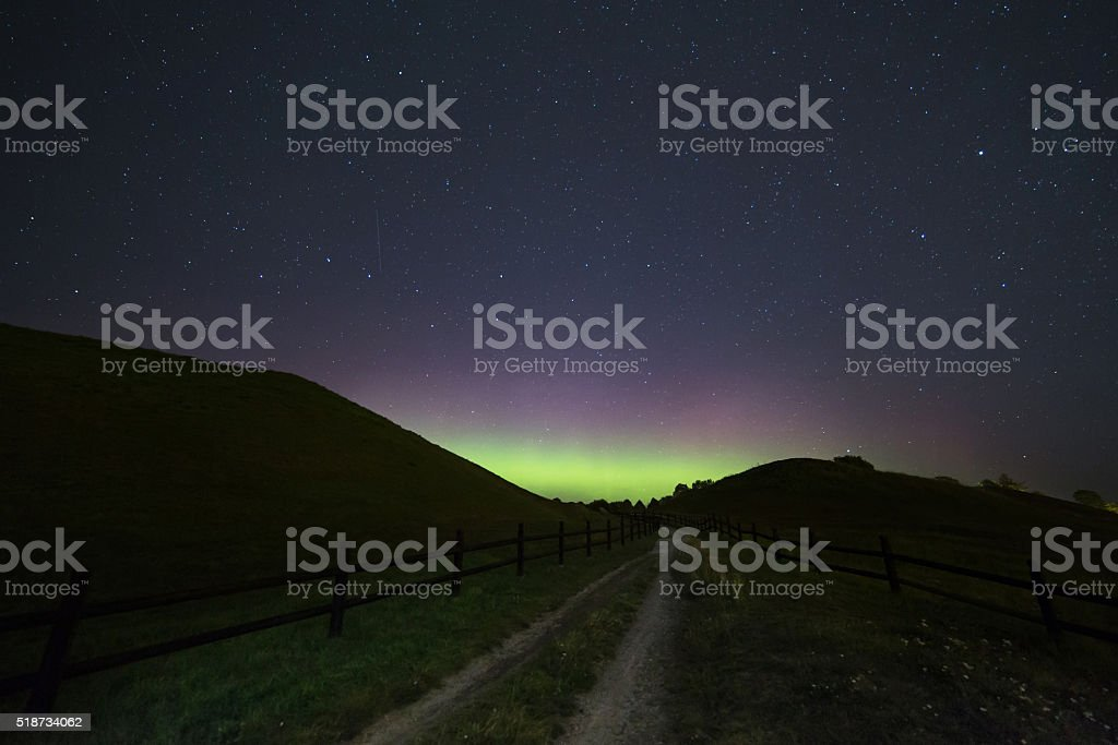 Aurora and old graves stock photo