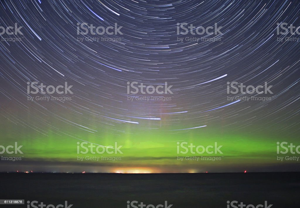 Aurora and Startrail backgrou d stock photo