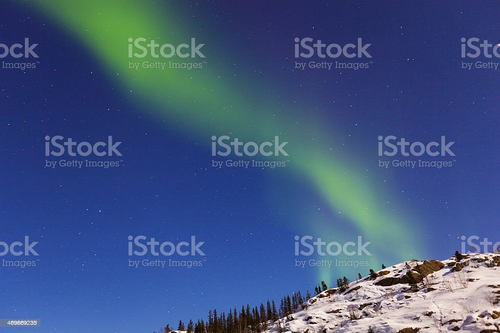 Aurora appears over a snow covered mountain  Rm royalty-free stock photo