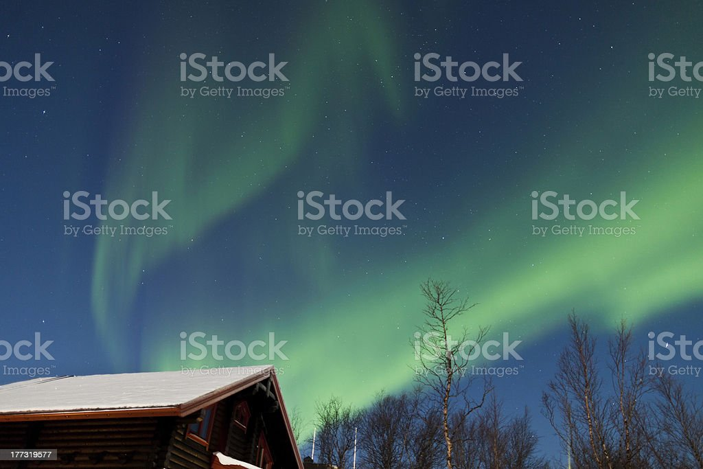 Aurora Borealis (Northern Lights) above a cabin royalty-free stock photo