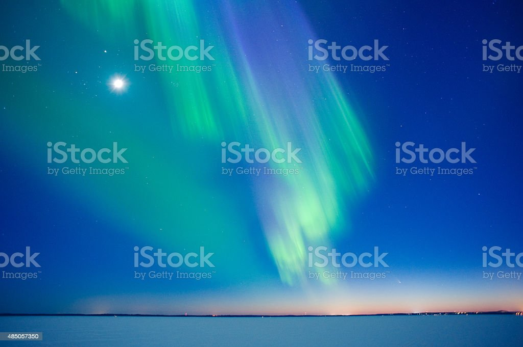 Aurora Borealis and Moon stock photo