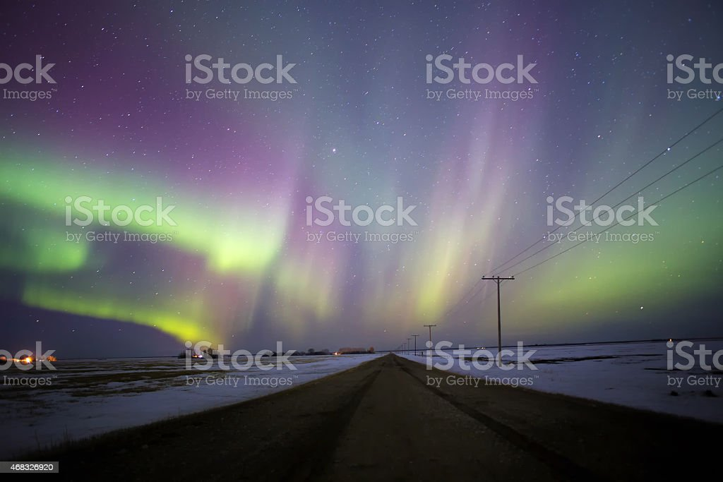 Aurora borealis fanning over road stock photo