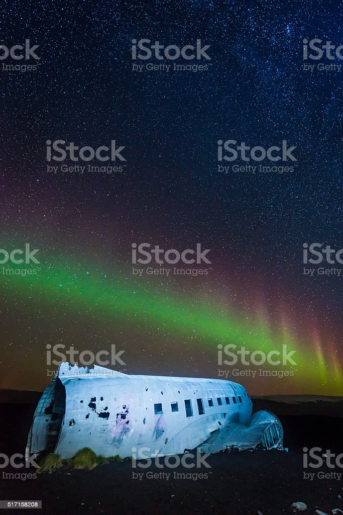 Aurora Borealis Northern Lights in starry sky above plane Iceland stock photo
