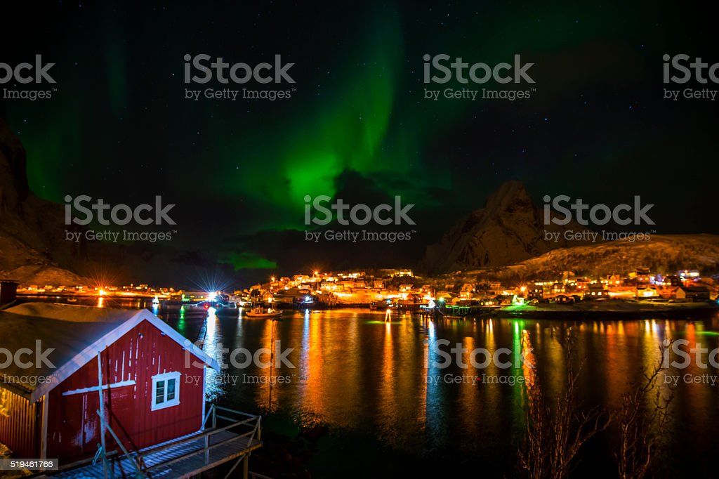 Aurora borealis - Northern Lights over village stock photo