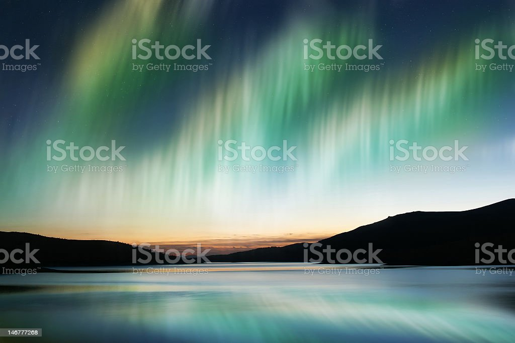 Aurora Borealis over a body of water royalty-free stock photo
