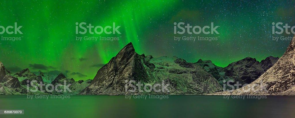 Aurora borealis over a fjord on the Lofoten in Norway stock photo