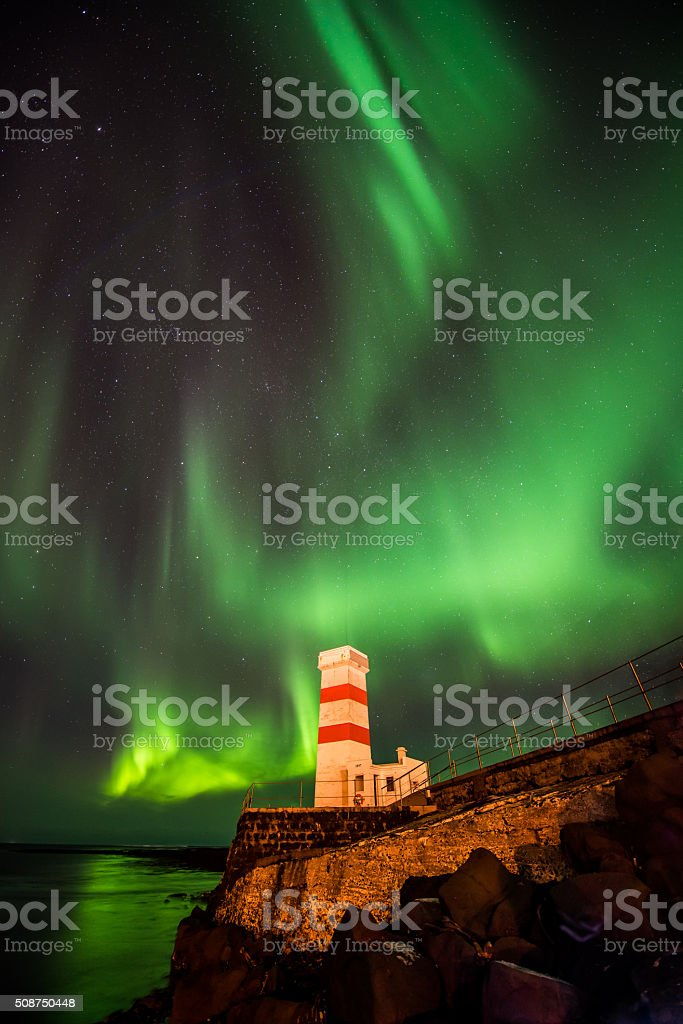 Aurora Borealis over a lighthouse in Iceland stock photo