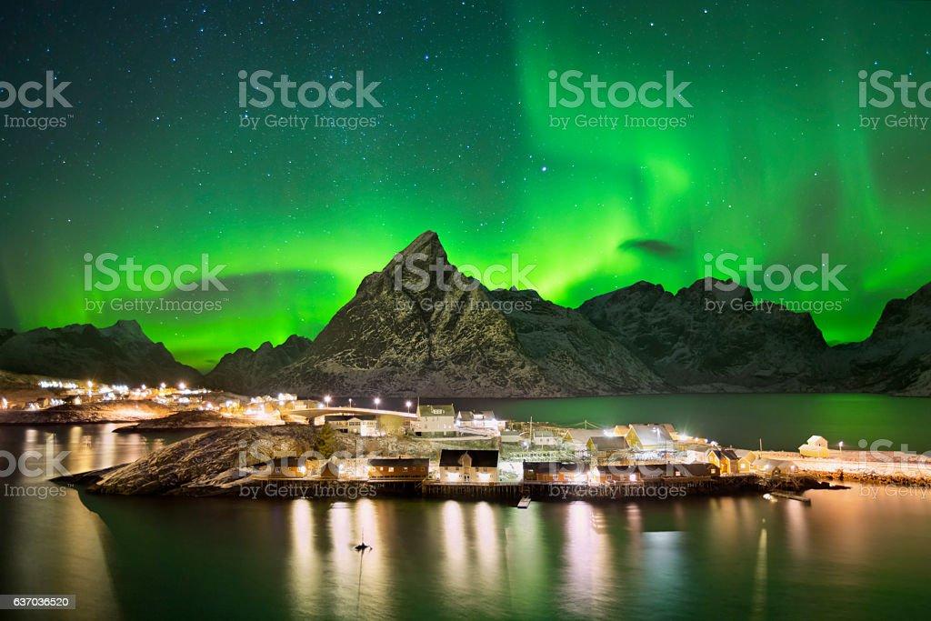 Aurora borealis over a village on the Lofoten in Norway stock photo