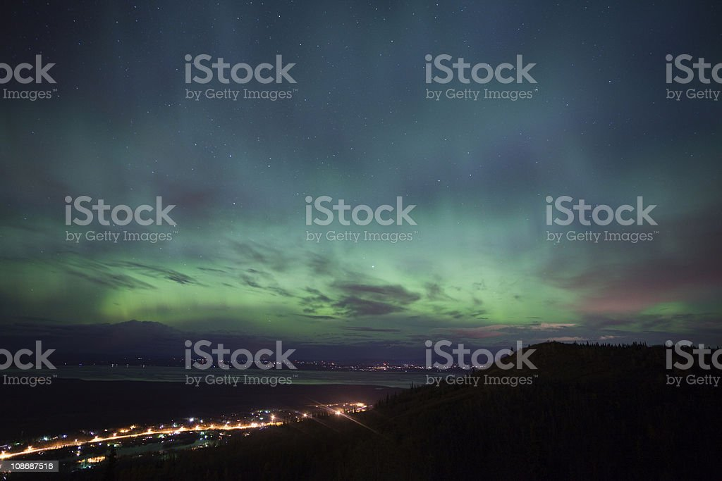 Aurora Borealis over alaskan towns stock photo