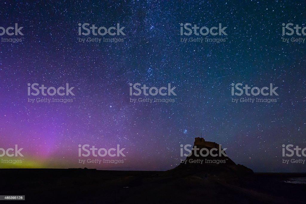 Aurora Borealis over Lindisfarne Castle stock photo