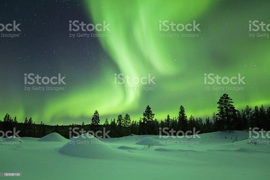 Aurora borealis over snowy landscape winter, Finnish Lapland stock photo