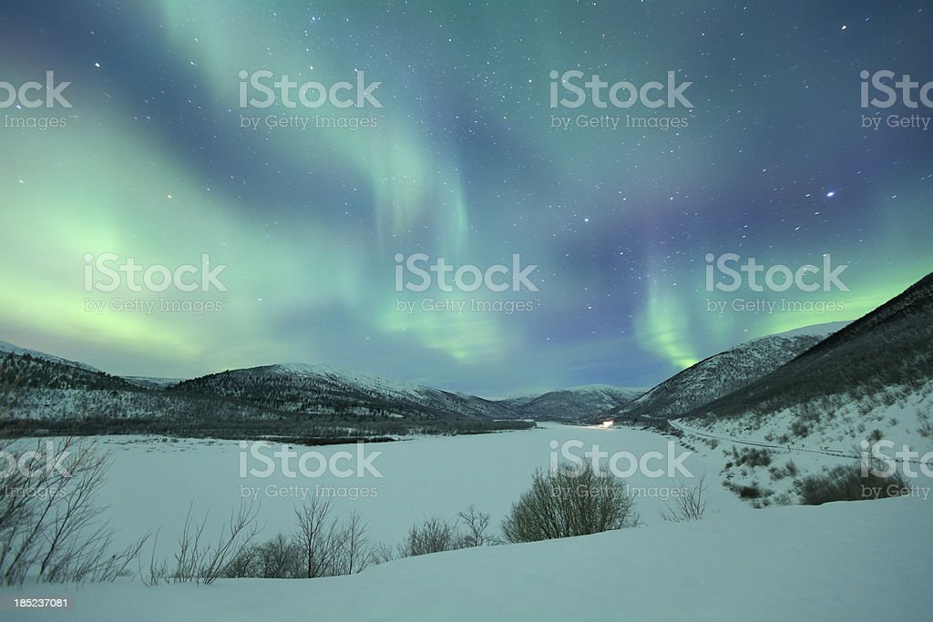 Aurora borealis over snowy landscape winter, Finnish Lapland stock photo