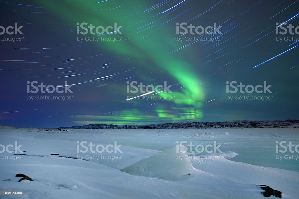 Aurora borealis over snowy landscape winter, northern Norway stock photo