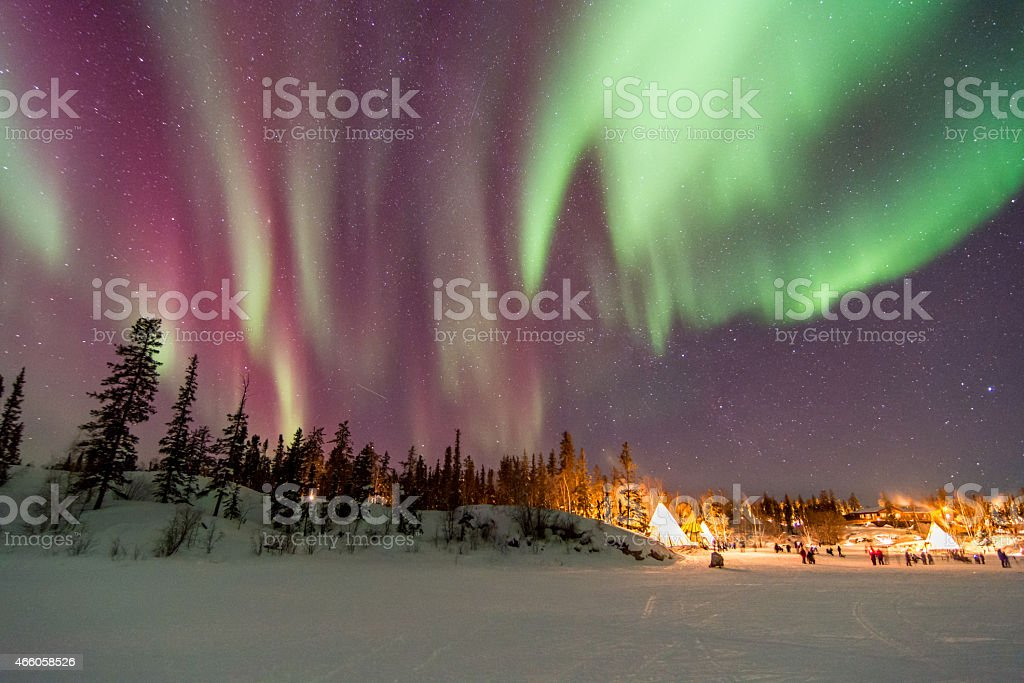 Aurora Borealis over tepees in Yellowknife stock photo