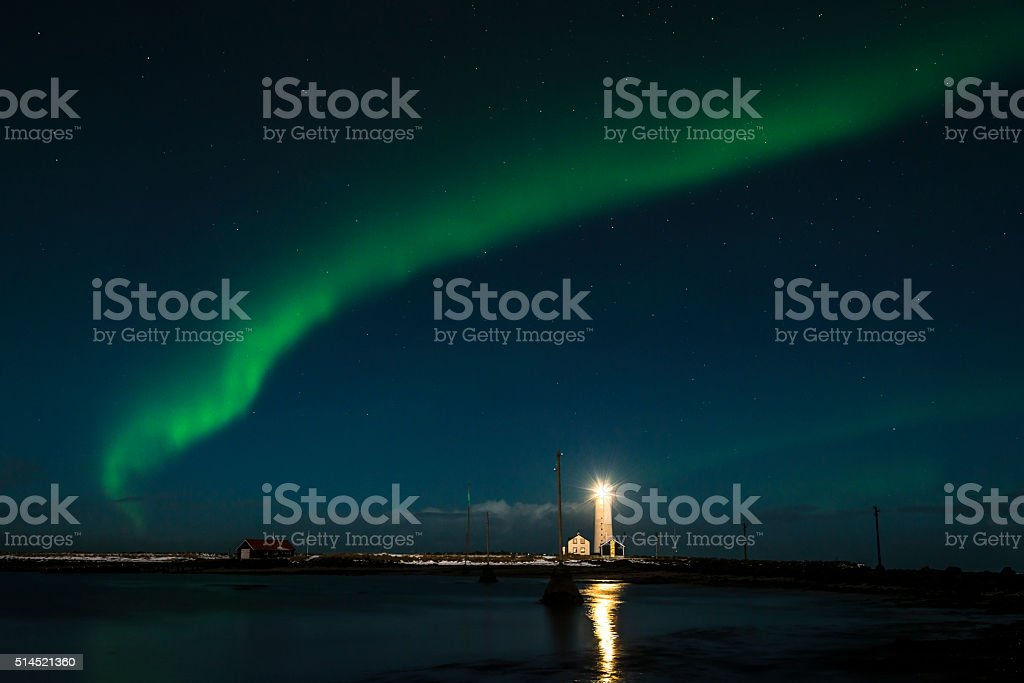 Aurora Borealis over the  lighthouse in Reykjavik. Iceland. stock photo