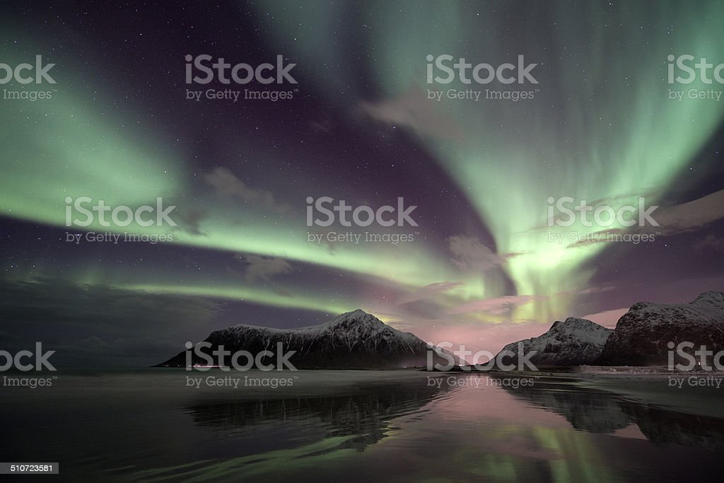 aurora borealis over the Lofoten Island of Flakstad?ya, Arctic Norway stock photo