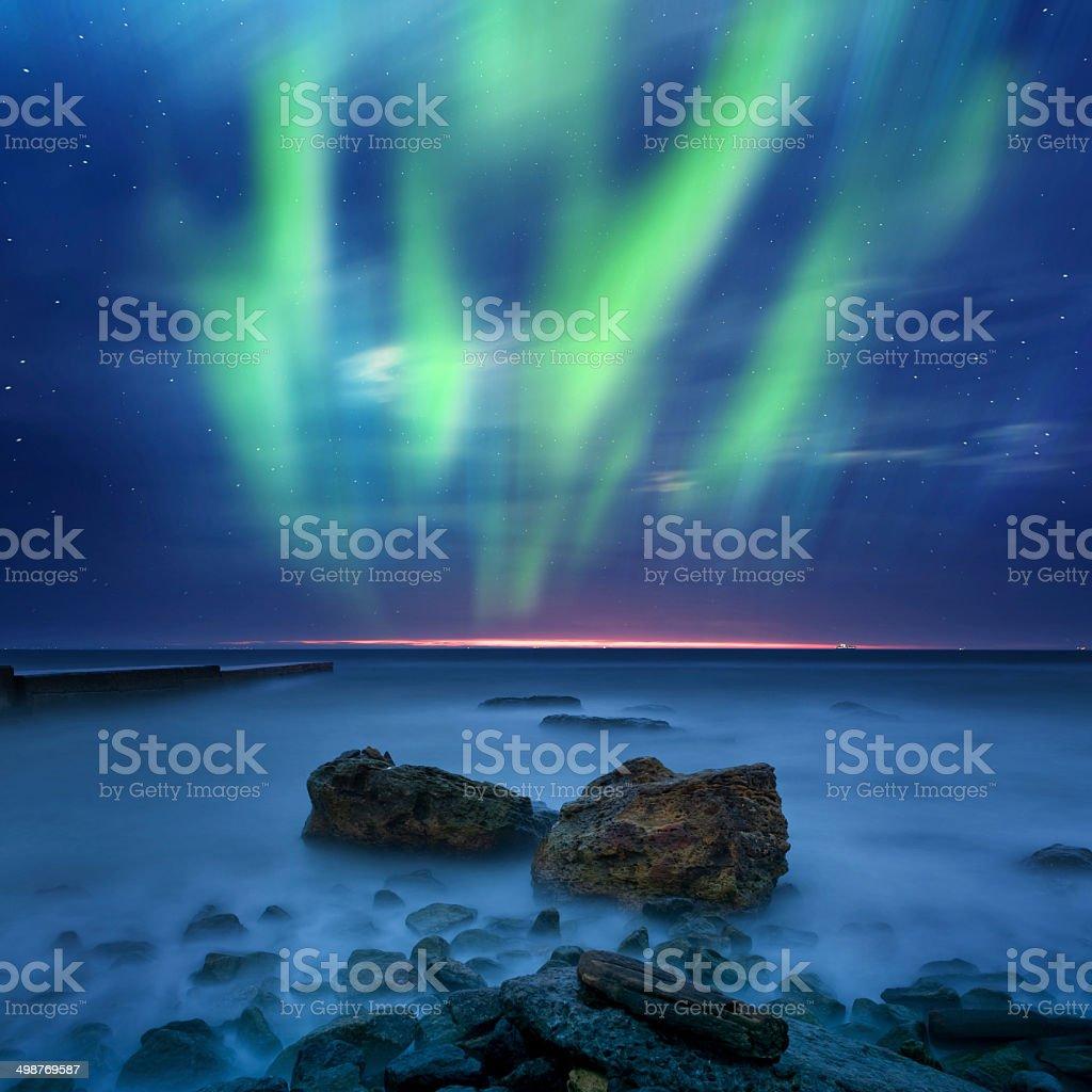 aurora borealis over the sea stock photo