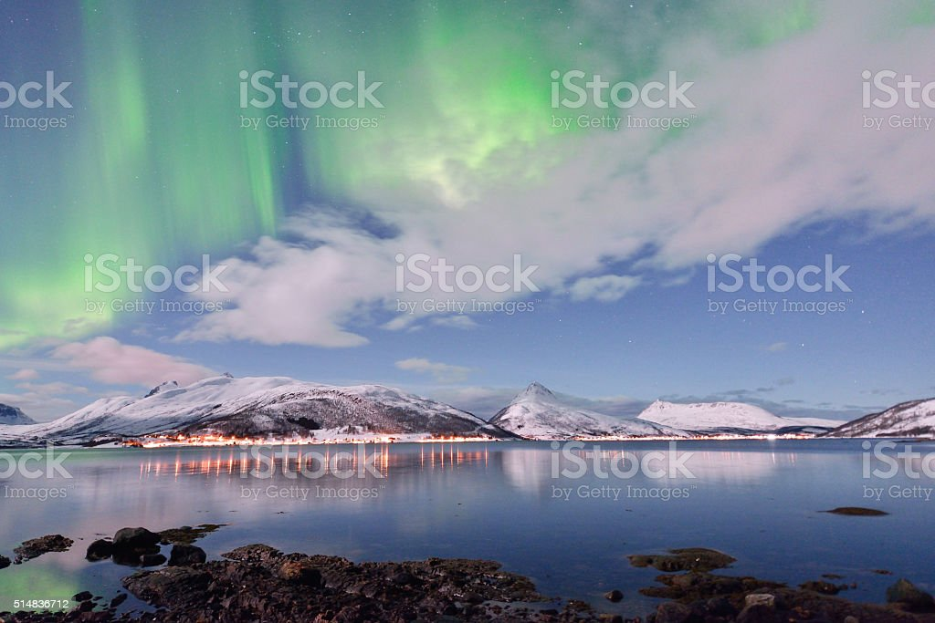 Aurora Borealis under Full Moon in Senja, Norway stock photo