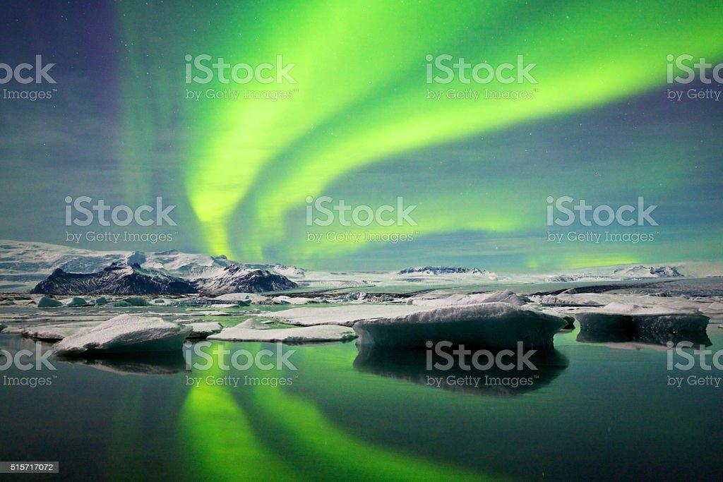 Aurora Fanning Out Over Jökulsárlón Glacial Lagoon stock photo