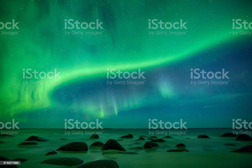 Aurora in Uttakleiv Beach, Lofoten, Norway stock photo