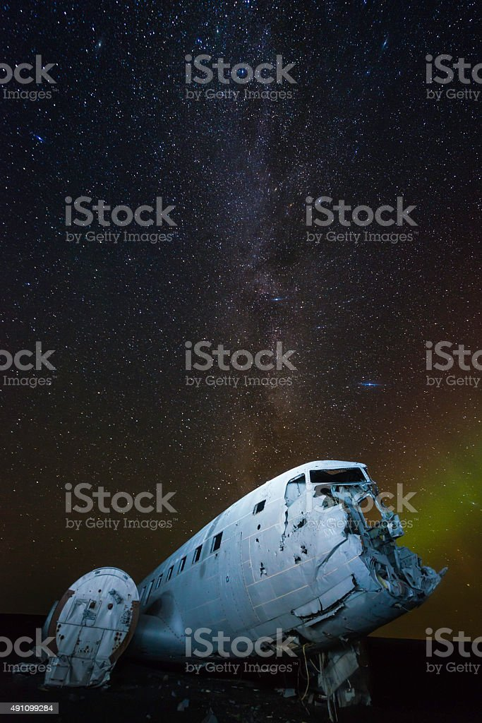 Aurora milky way galaxy stars over plane crash beach Iceland stock photo