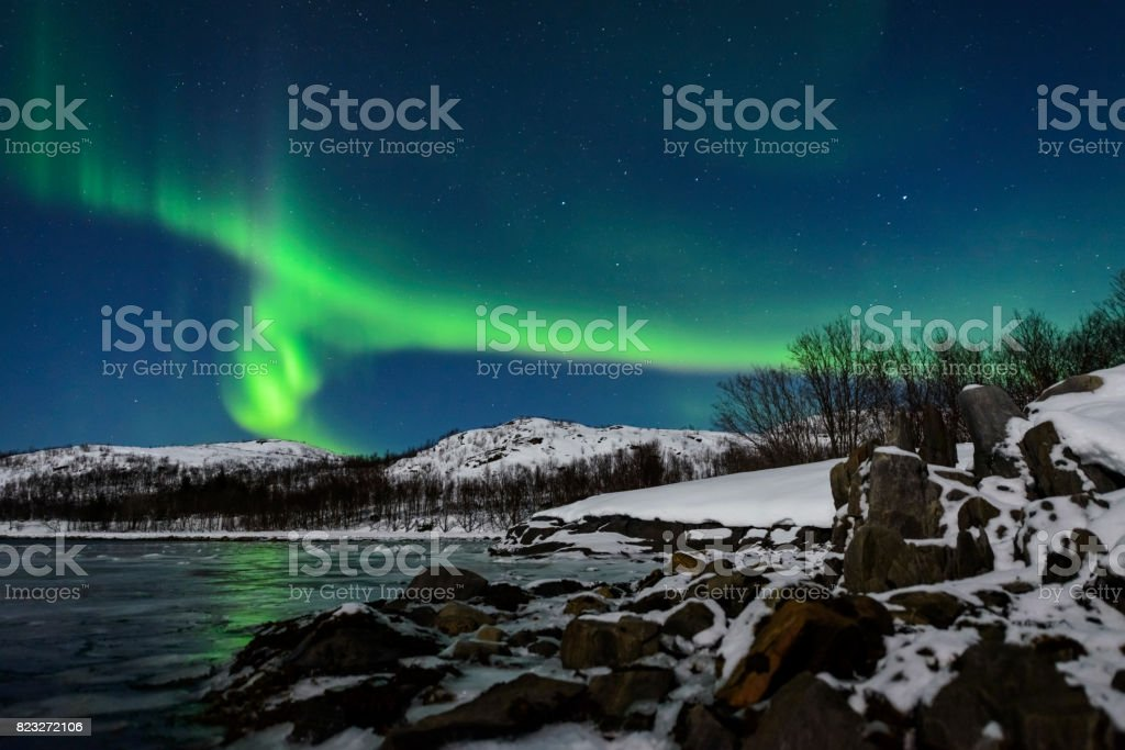 Aurora Northern Polar light in night sky over Northern Norway stock photo