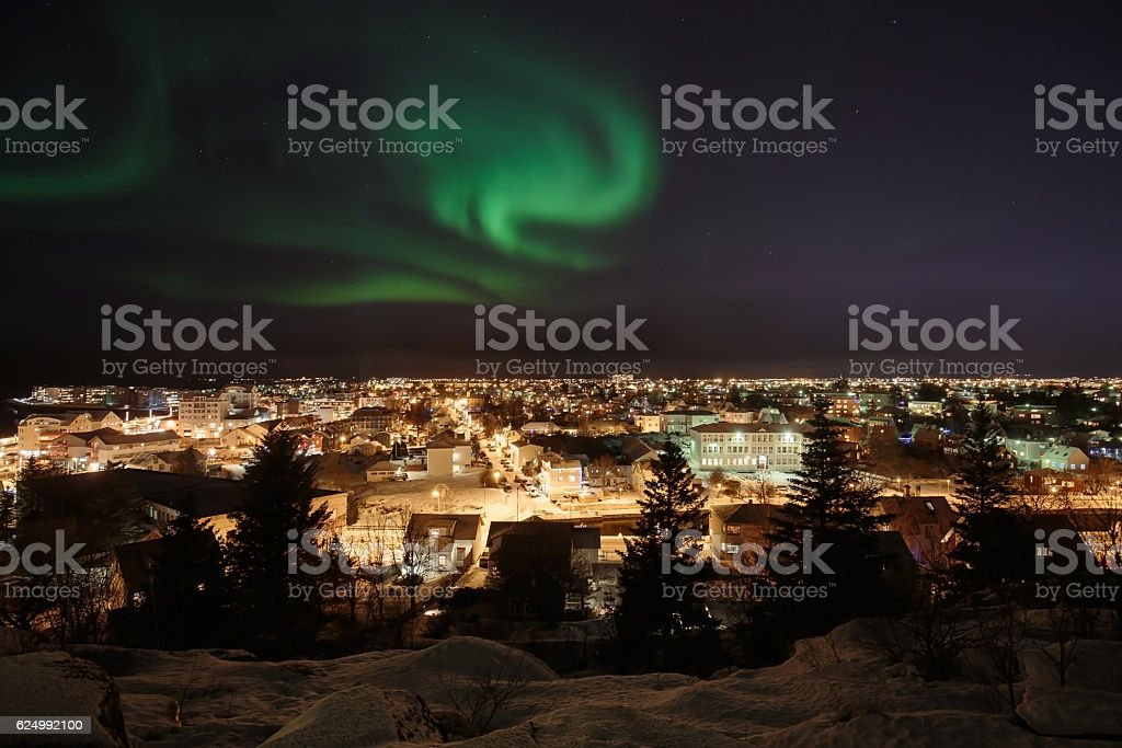 Aurora over Reykjavik stock photo