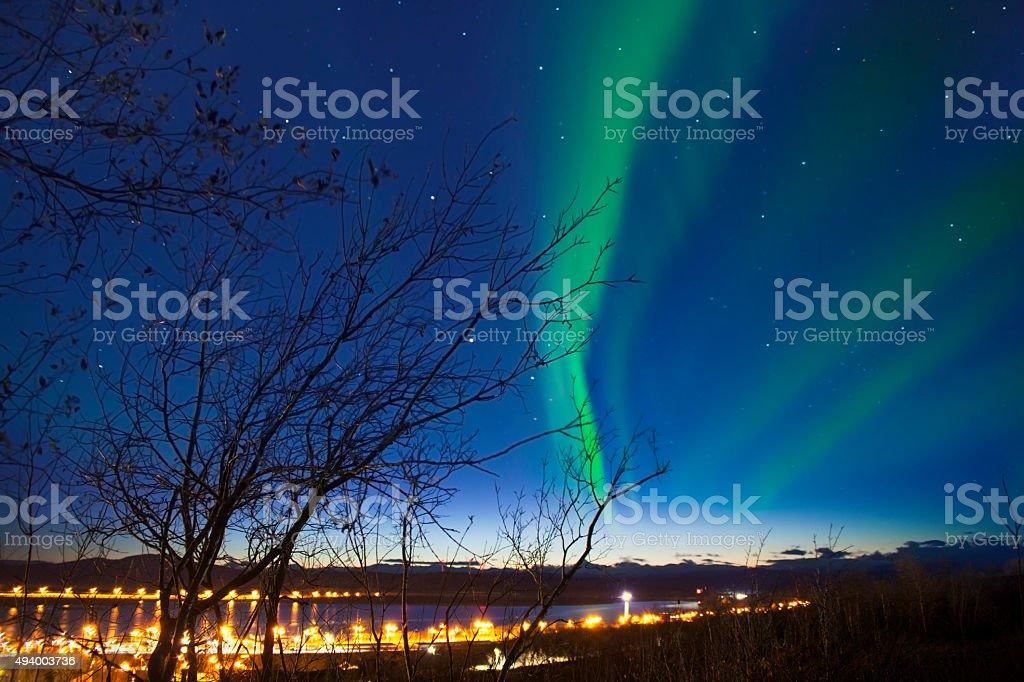 Aurora with light on the horizon at Kiruna Cityscape, Sweden stock photo