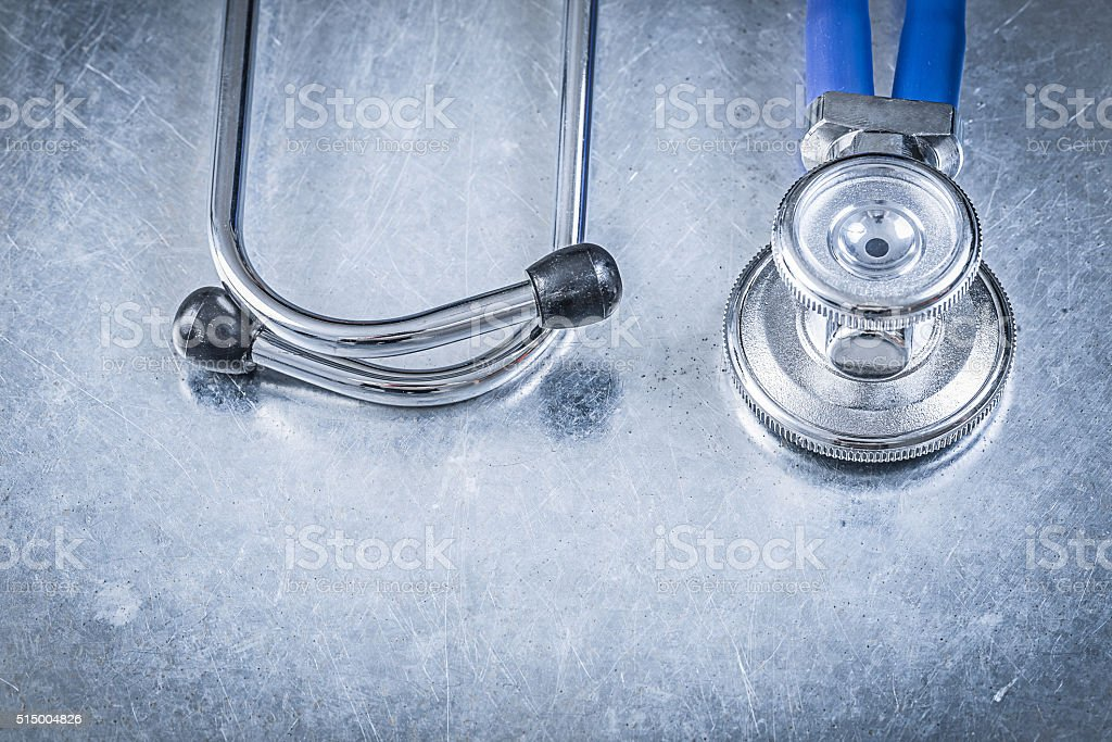 Ausculator diagnostic tool on scratched metallic background medi stock photo