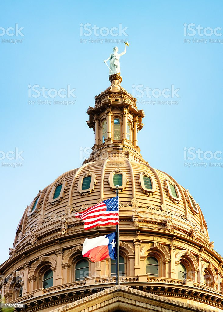 Austin Texas Capitol dome with American and Texan flags stock photo