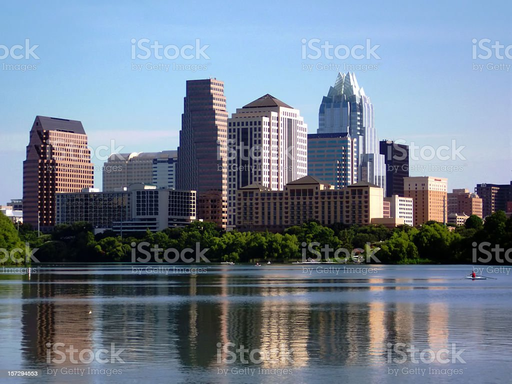 Austin Texas City Skyline at Sunrise with Sculler stock photo