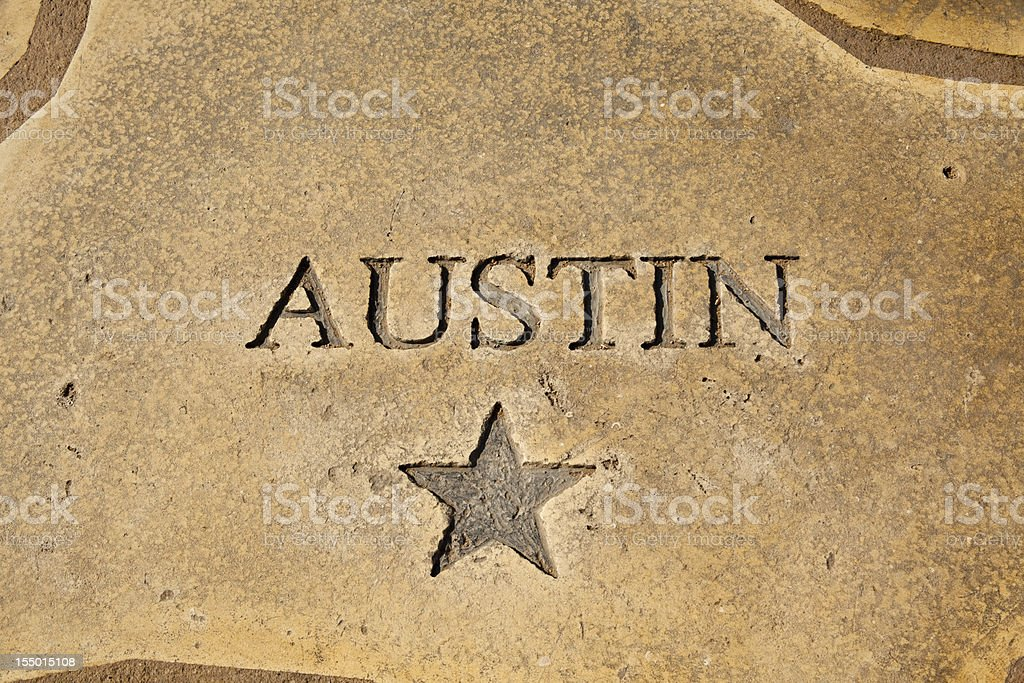 Austin, Texas shown on map of concrete. Star, state capitol. stock photo