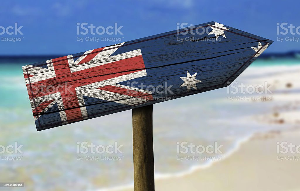 Australia flag wooden sign with a beach on background stock photo