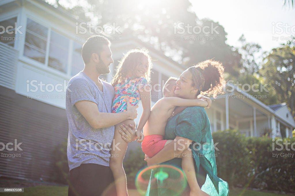 Australian aboriginal family enjoying in the garden at home stock photo